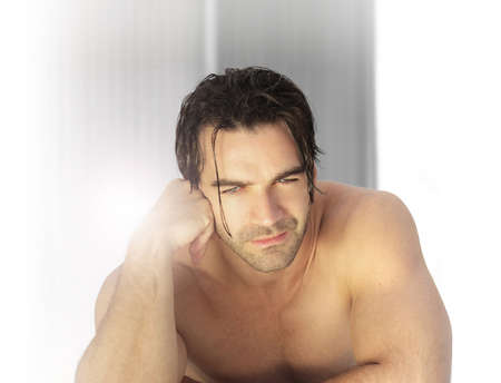 wet men: Young sexy masculine male model with bare torso in spa environment