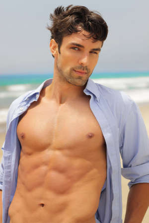 Good-looking man with seductive expression with open shirt revealing sexy body  photo