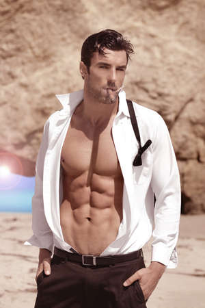 Sexy handsome playboy outdoors with shirt open revealing hot body and nice abs Stock Photo - 14655967