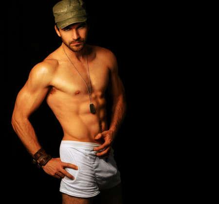 homme nu: Portrait provocateur ultra m�le masculin mod�le en sous-v�tements, avec copie espace Banque d'images