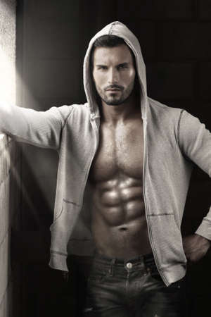 Very sexy male model with open jacket revealing muscular body and nice abs and chest Banque d'images