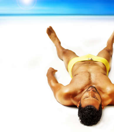 nude man: Good looking muscular young man lying outside in sun Stock Photo