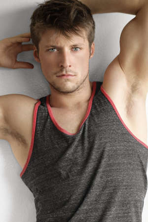 Handsome young man with arms up and expression