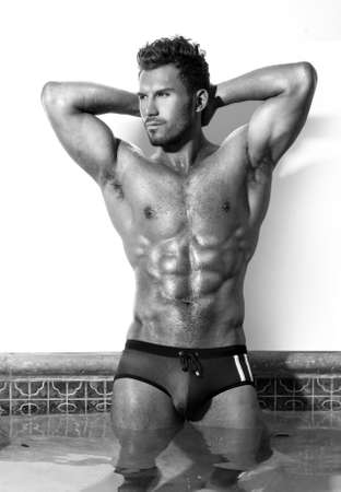 six pack abs: Sexy fine art black and white portrait of a very muscular male model  in swimsuit