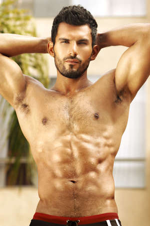 Healthy muscular young man with nice abs photo