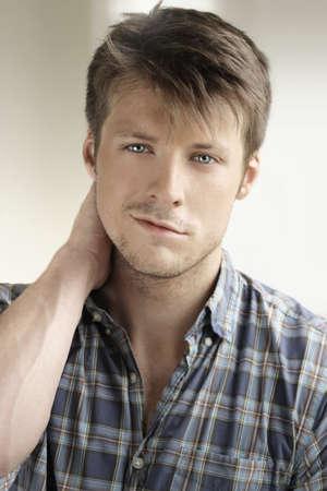 smirk: Handsome young man portrait  Stock Photo