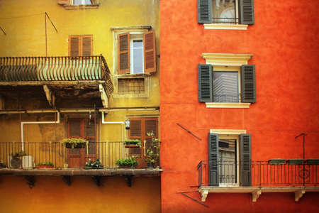Very old building facades in Europe with windows  photo