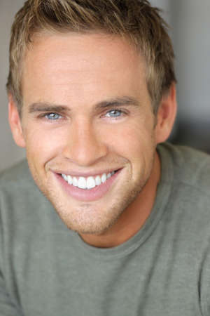 Close-up portrait of a young attractive man with great toothy smile 스톡 콘텐츠