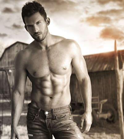 Sepia toned portrait of a hunky male model in nostalgic outdoor rustic setting Stock Photo - 15175340
