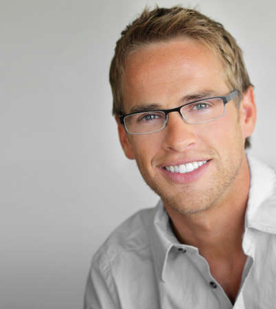 man glasses: Young cool trendy man with glasses smiling