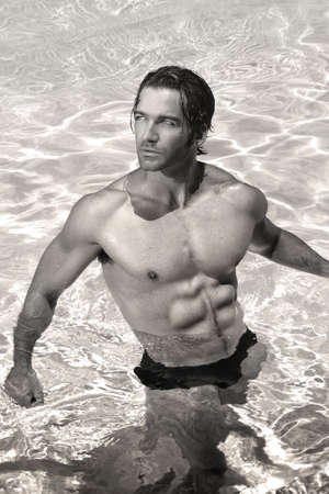 nude wet: Fine art black and white sexy portrait of a young healthy good looking macho man model athlete