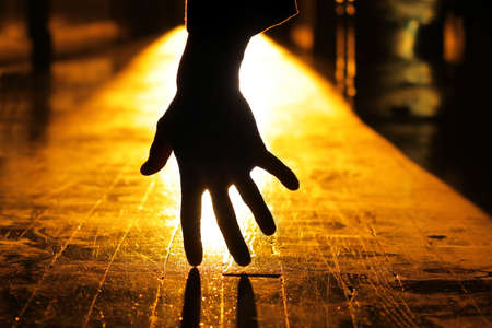Concept haunting image of a backlit hand