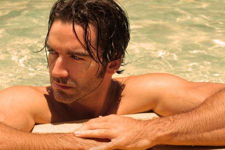 looker: Detailed portrait of a beautiful male model in swimming pool