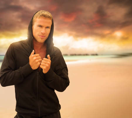 Portrait of a handsome young man on the beach at sunset Stock Photo - 16333297