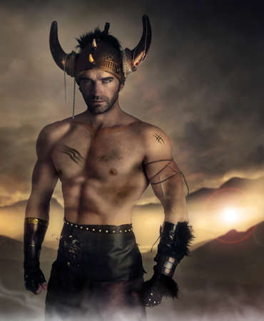 warrior tribal: Moodey portrait of a muscular man as ancient warrior on battlefield Stock Photo