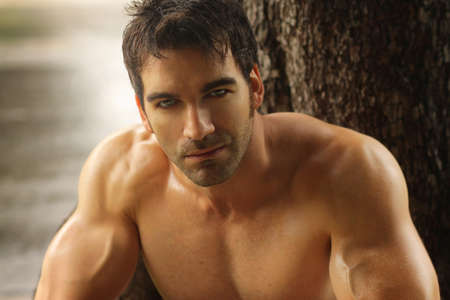 Sexy masculine man shirtless outdoors against tree Stock Photo - 16490727