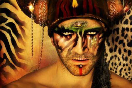 z�bres: Portrait concept de mode stylis�e d'un jeune homme avec maquillage tribal et �l�ments d'origine animale devant un fond imprim� animal