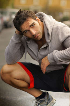 Outdoor portrait of a good-looking young active man photo