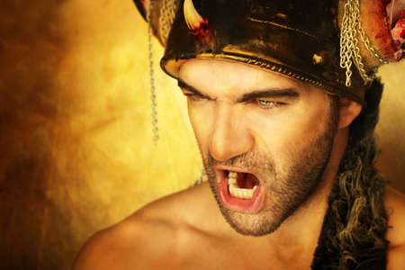 viking helmet: Sexy powerful warrior screaming against golden background