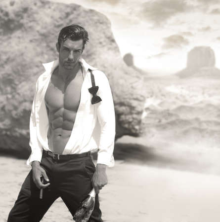 Sexy male model  in open formal attire exposing great toned muscular body and abs