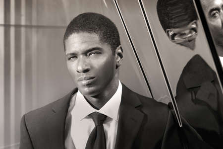suave: Portrait of a cool young businessman in modern setting in suit and tie