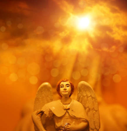 heavenly angels: Detail of angel holding glowing ring against majestic glorious heavenly background Stock Photo