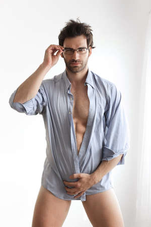 Sexy male model with hot naked body wrapped in business shirt wearing eyeglasses Stock Photo - 17383351