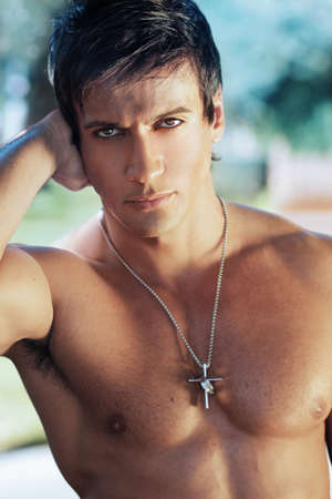 male: Close-up portrait of handsome shirtless man outdoors