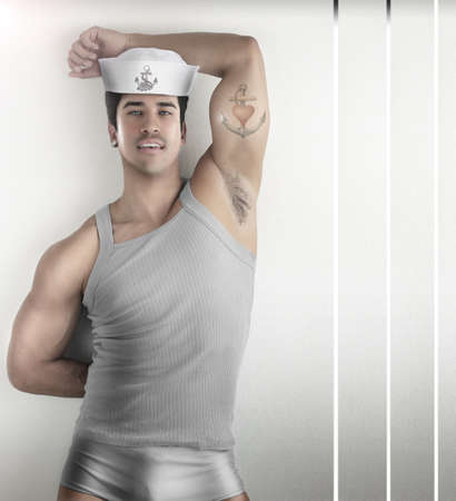 Sexy fashion portrait of a male model in provocative sailor outfit against modern futuristic background