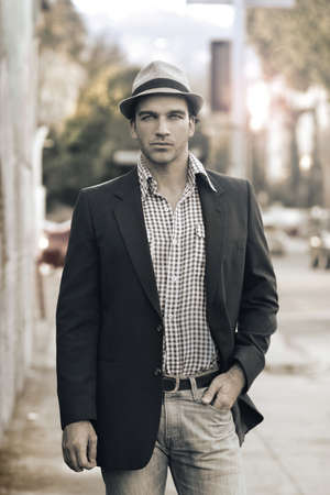 blazer: Male model posing on street in trendy casual outfit and hat