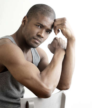 black man: Studio portrait of a good looking young black man against white background with copy space