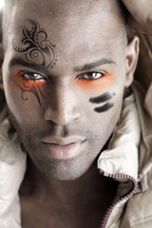 Close-up detailed portrait of a male model in fashion beauty make-up photo