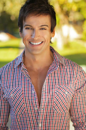 young male model: Handsome man outdoors with great big smile Stock Photo