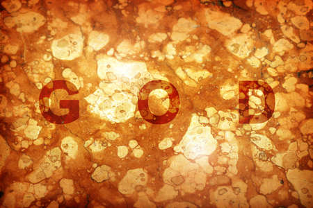 word of god: The word GOD on on ancient stone background with lighting effects