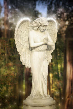 kingdom of heaven: Fantastical glowing statue of an angel in magical garden setting
