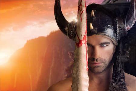 ファンタジーの背景を持つ剣を保持している美しい若い戦士の肖像画