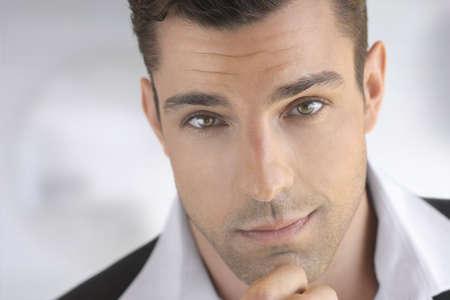 Closeup portrait of a young attractive man thinking Standard-Bild