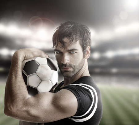 Sexy muscular man athlete with ball