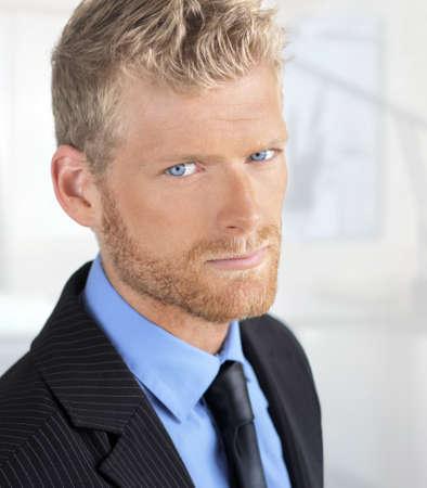 Close up portrait of young handsome serious business man Foto de archivo