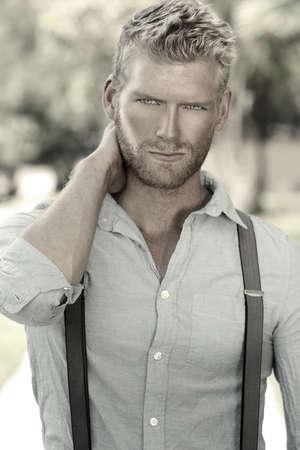 confident man: Outdoor portrait of a handsome young confident man