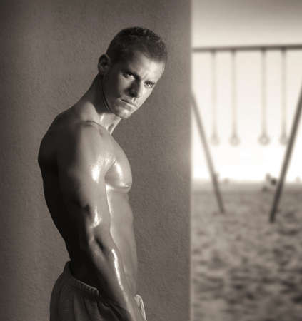 determination: Portrait of a sexy shirtless young male fitness model turning Stock Photo