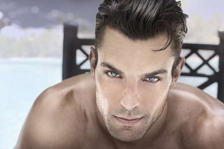 good looks: Closeup portrait of a beautiful male model with blue eyes and great hair Stock Photo