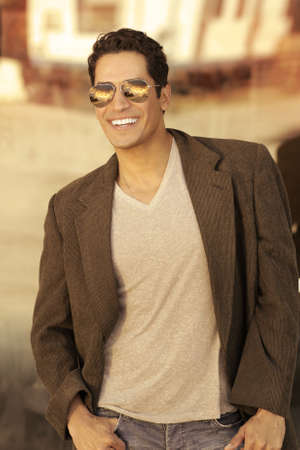 Portrait of a sexy young man in sunglasses with big smile photo