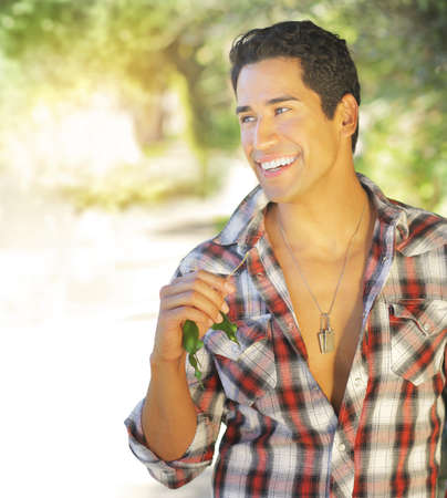 Great looking male model with nice big smile outdoors photo