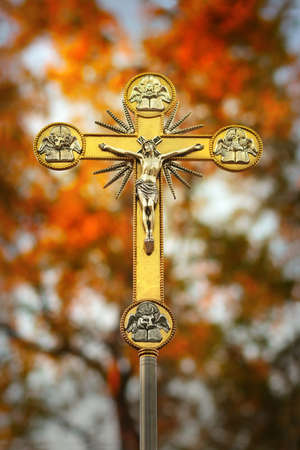 Beautiful glowing ornate golden crucifix of Jesus on the cross with natural