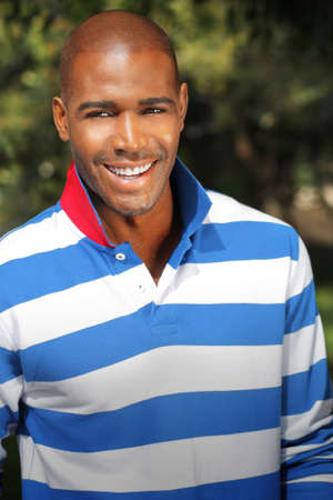 Smiling male model in casual trendy clothing outdoors