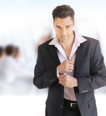 Portrait of a young confident businessman in office setting Foto de archivo