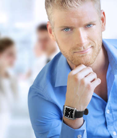 Good-looking young businessman in office setting