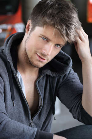 Portrait of a sexy playful young man