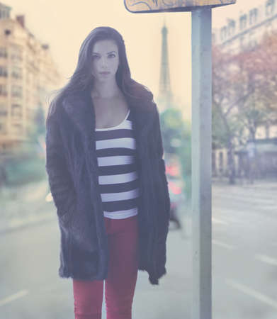 Fashion portrait of pretty young female model on the streets of Paris with a vintage retro styling Banco de Imagens